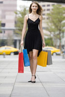 girl holding shopping bags walking
