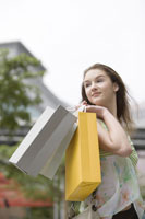 girl holding shopping bags smiling