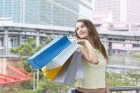 girl carrying shopping bags outdoors