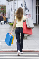 girl carrying shopping bags walking