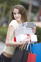 girl holding shopping bags & gifts