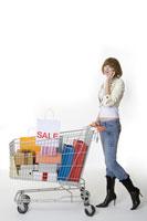 girl on the phone pushing shopping cart