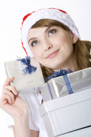 Teenage girl holding stack of gifts