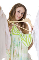 Teenage girl holding dress