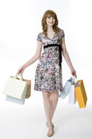 Teenage girl holding shopping bags