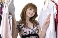 Teenage girl standing between clothing