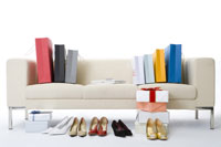 High heels and shopping bags by sofa