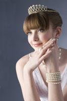 Teenage girl wearing jewelries smiling