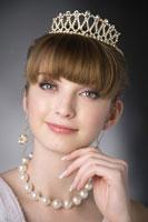 Teenage girl wearing jewelries and crown