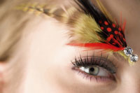 girl with makeup & feather