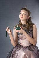 girl holding perfume sprayer