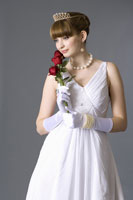 girl in formal dress holding roses
