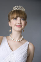 girl in formal dress wearing jewelries