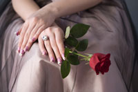 girl with rose & artificial fingernails
