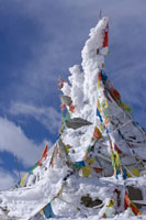 Prayer flags covered by snow