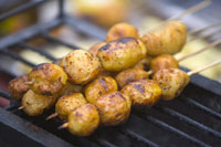 Potatoes skewers on grill