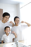 Family with daughter brushing teeth
