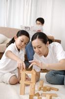 Mother & daughter playing blocks