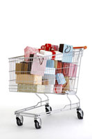 Shopping bags and gifts in shopping cart