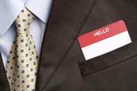 Businessman with�f hello�f card