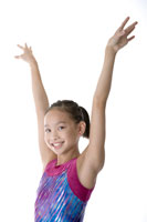 girl standing with her arm raised