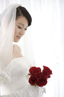 Young bride holding roses