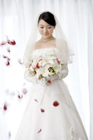 Young bride with flying petals