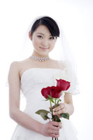 bride holding three roses