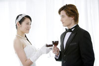 Bride & groom toasting with glasses