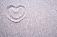 Heart shape drawn in white sand