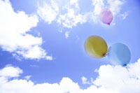 Balloons flying in sky