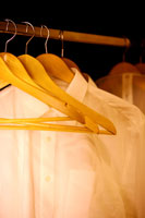Shirts on hanger in wardrobe