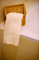 Bathtub with basket and towel