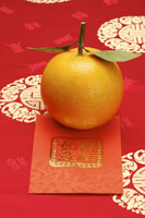 Oranges and red envelope