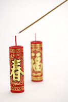 Incense about to lit firecracker
