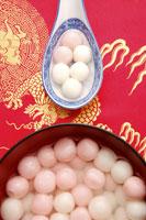 Dumplings in spoon & a bowl of dumplings