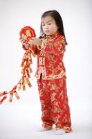 Girl holding firecrackers