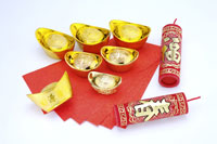 Firecrackers, gold bowls & red envelopes