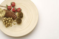 Pine cone and berries on plate