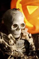 Human skeletons and illuminated pumpkin