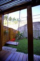 Wooden swing in garden