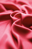 Detail of red rippled satin