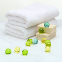 Folded towels, soaps, bath beads