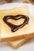Toast with heart shaped chocolate sauce