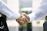 Close-up of two business men shaking hands