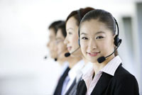 Business people wearing head phone in a row