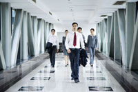 Business people walking in the office building