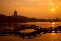 Leifeng Pagoda in Evening Glow and causeway in West Lake