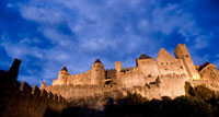 Castle walls illuminated at night