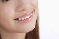 Close-up of young woman's braces